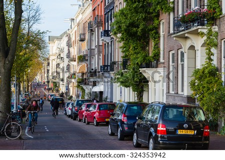 AMSTERDAM, THE NETHERLANDS - NOVEMBER 10: Amsterdam street with 17th century residence buildings in the city center, Netherlands on November 10, 2014. - stock photo