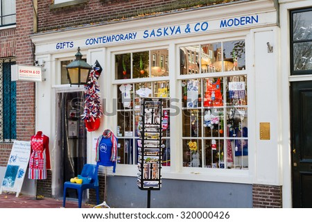 AMSTERDAM, THE NETHERLANDS - NOVEMBER 11: Facade of a souvenir shop in Amsterdam, The Netherlands on November 11, 2014. Gift shop with a good interior design to attract customers.