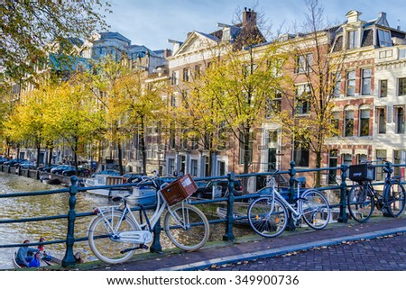 AMSTERDAM, THE NETHERLANDS - NOVEMBER 10: Traditional dutch bicycle parked at the bridge in Amsterdam, The Netherlands on November 10, 2014. There are few milion bicycles in Amsterdam itself. - stock photo