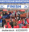 AMSTERDAM, THE NETHERLANDS - OCT 17: Getu Feleke of Ethiopia wins the 35th edition of the Amsterdam Marathon by setting a new course record, October 17, 2010 in Amsterdam, The Netherlands - stock photo