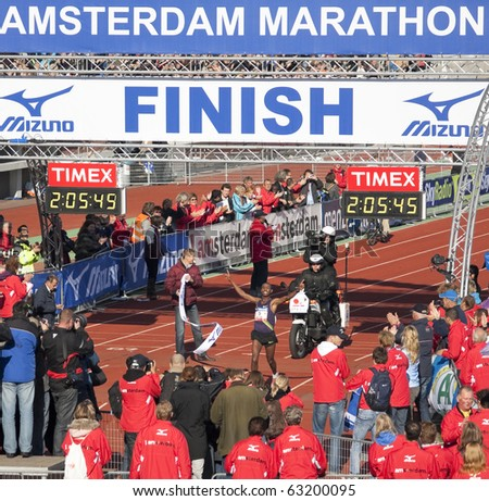 AMSTERDAM, THE NETHERLANDS - OCT 17: Getu Feleke of Ethiopia wins the 35th edition of the Amsterdam Marathon by setting a new course record, October 17, 2010 in Amsterdam, The Netherlands
