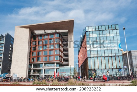 Amsterdam, the Netherlands - October 16, 2013: Modern buildings of Conservatory and Library,cultural centres,example of modern architecture and design of Amsterdam. - stock photo