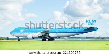AMSTERDAM, THE NETHERLANDS - SEPT 27, 2015: KLM Asia Boeing 747-406 (M) takes off from Schiphol Airport