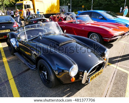 Amsterdam, The Netherlands - September 10, 2016: Black Cobra replica Dax 1993 on display during Cars & Coffee XXL show. Non-ticketed public event held in the streets of the city, people carspotting.