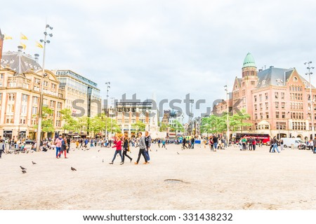 AMSTERDAM, THE NETHERLANDS - September 5: View of the Dam square, March 5, 2012 in Amsterdam, The Netherlands. The place is the historical center of the city and includes the Royal Palace. - stock photo