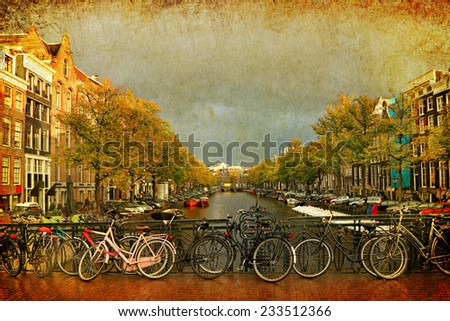 Amsterdam traditional canal street with mooring boats, bridge and parking bicycles view. Golden fall of  Netherlands. Photo in retro style. Paper texture. - stock photo