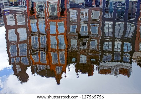 Amsterdam. Typical architecture. Facades of old houses are reflected in channel water - stock photo