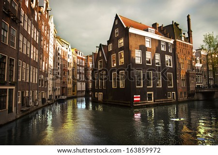 Amsterdam water channels with buildings - stock photo