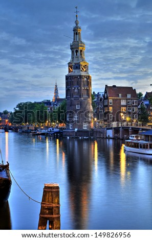 Amsterdam,  with the famous Montelbaanstower at dusk