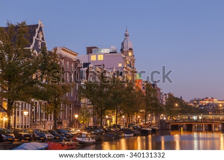 Amsterdams city with canal at dusk twilight - stock photo