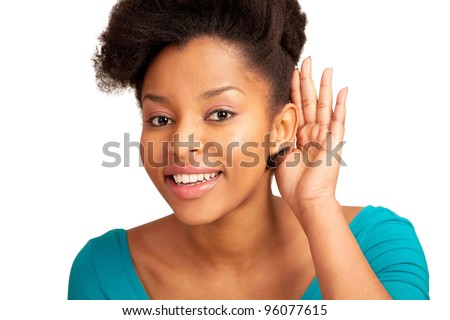 Amused girl cupping ear and listening to something - stock photo