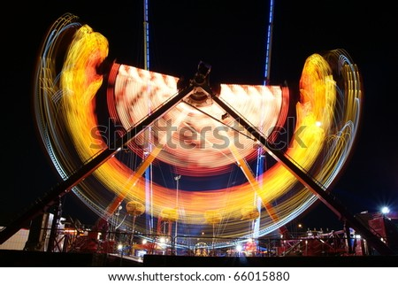Amusement park at night - stock photo