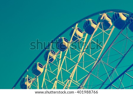 amusement park, ferris wheel, retro vintage style effect - stock photo