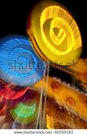 Amusement park ride at night - stock photo