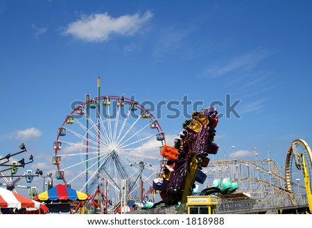 Amusement park rides on the boardwalk, Seaside, New Jersey - stock photo