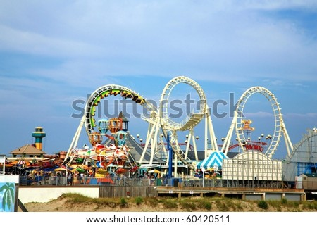 Amusement park rides with copy space - stock photo