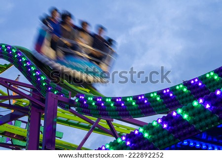 Amusement park with carousel and evening colorful lights - stock photo