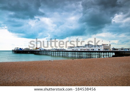 Amusement pier and boardwalk of Brighton in England - stock photo