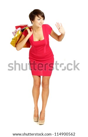Amusing girl in a coral dress successfully acquired gifts - stock photo
