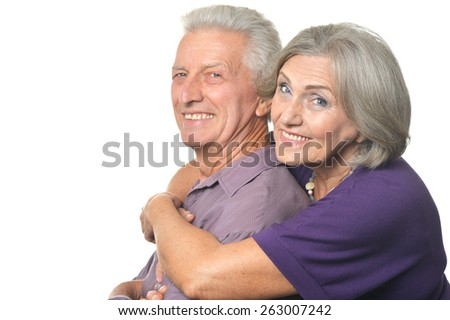 Amusing happy smiling old couple isolated on white background - stock photo