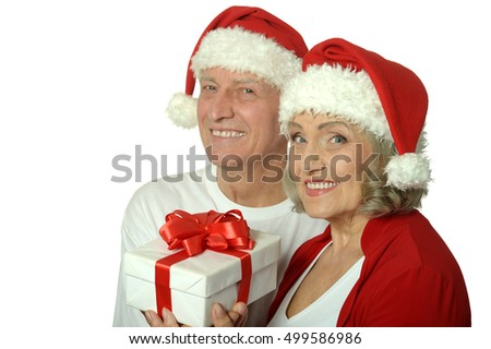 Amusing old couple  with gift