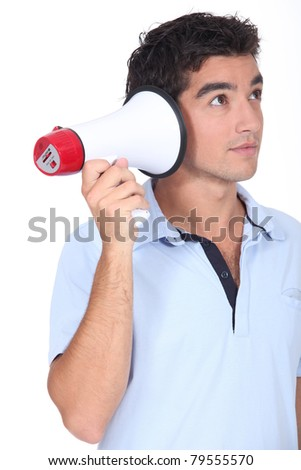 Amusing studio shot of man with a megaphone
