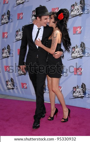 Amy Winehouse & husband at the 2007 MTV Movie Awards at the Universal Amphitheatre. June 3, 2007 Los Angeles, CA Picture: Paul Smith / Featureflash - stock photo