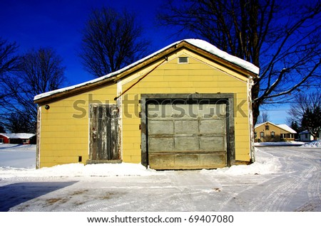 an abandon gas station on a winter day - stock photo
