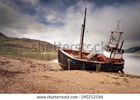An abandoned boat ruin on the shore of Loch Linnhe, Ardgour, Scotland - stock photo