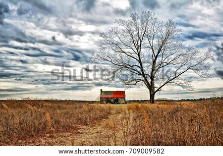 stock-photo-an-abandoned-farmhouse-and-o