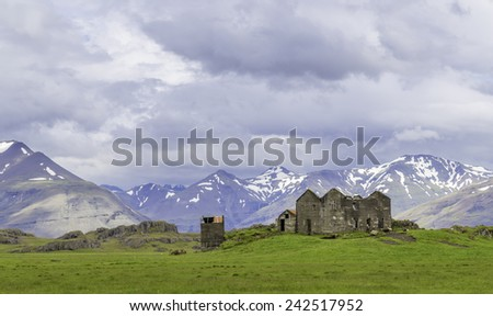 An abandoned house falling into ruin in rural Iceland - stock photo