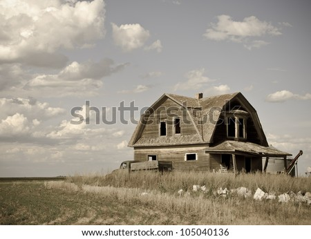 An abandoned old house with a vintage look. - stock photo