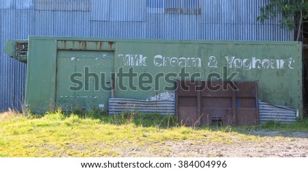 """An Abandoned Refrigerated Container with """"Milk Cream & Yogurt"""" Written on the Side on a Farm near Tarr Steps within Exmoor National Park, Somerset,England, UK - stock photo"""