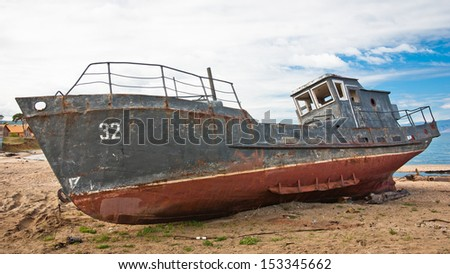 an abandoned ship in lake Baikal, Siberia, Russia - stock photo
