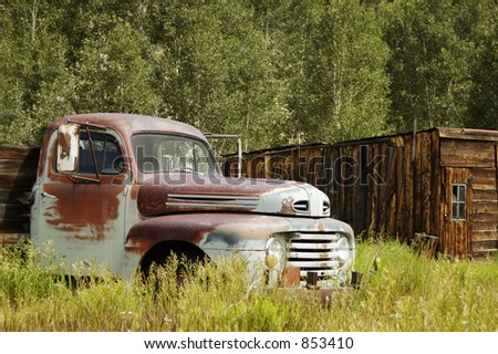 An abandoned truck left to the forces of nature. - stock photo