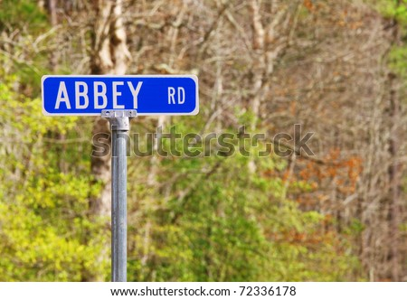 An Abbey road sign against the woods honoring the famed Beatles recording studio in London using selective focus and a shallow depth of field with room for your text. - stock photo