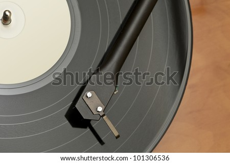 An above view of a turntable with vinyl record, cartridge and tone arm - stock photo