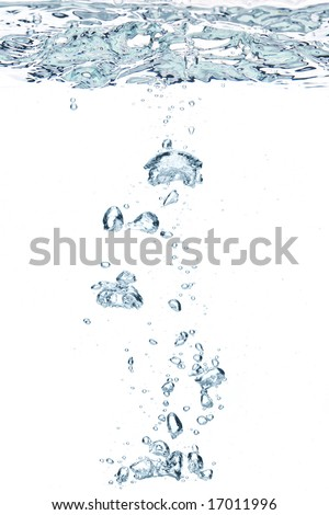 An abstract background created by air bubbles in water under blue lighting.