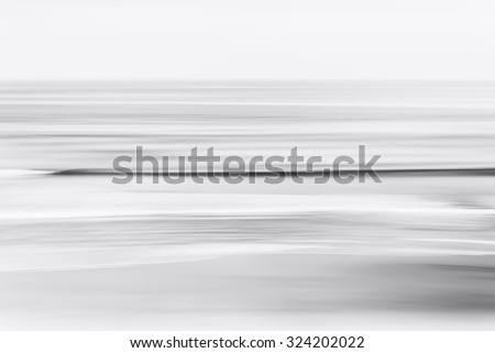 An abstract, black &and white seascape of the Pacific ocean off the coast of California.  A long exposure created a pleasing blurred effect. - stock photo
