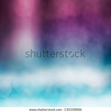 An abstract bokeh background with a blue to purple gradient. - stock photo
