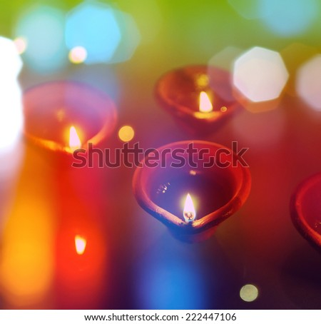 An abstract colorful Diwali greeting card cover with traditional diyas. - stock photo