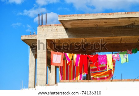 An abstract image of washing hanging at a building site.