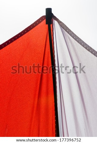 An abstract macro shot of a red and white umbrella.