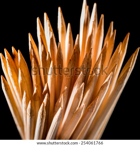 An abstract macro shot of some wooden toothpicks. - stock photo