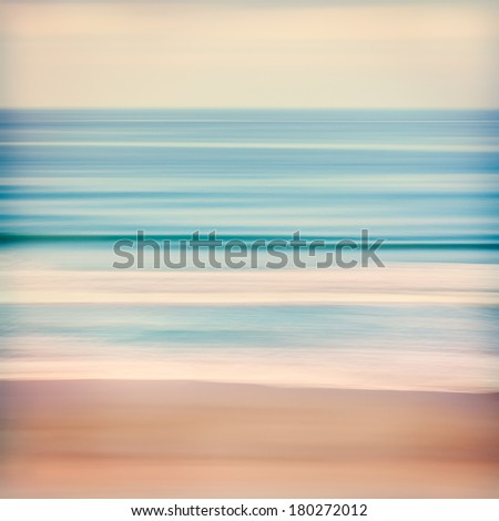An abstract ocean seascape with blurred panning motion.  Image displays a retro, vintage look with cross-processed colors. - stock photo