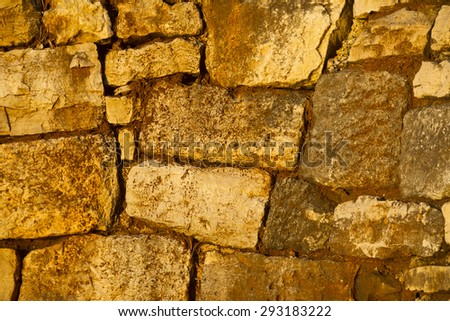 An abstract of a stone wall at sunset.