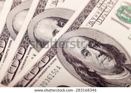 An Abstract of One Hundred Dollar Bills with Narrow Depth of Field closeup. Business concept. Selective focus, blurred background