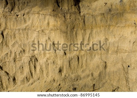 An abstract pattern of layers of sand which would create a good background texture. - stock photo