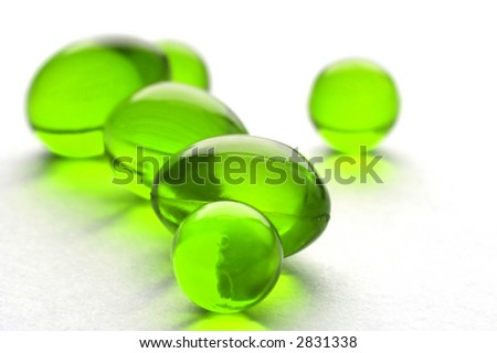 An abstract picture of vitamins pills in green color