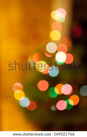 An abstract shot of multi-coloured Christmas tree lights causing a bokeh effect. - stock photo